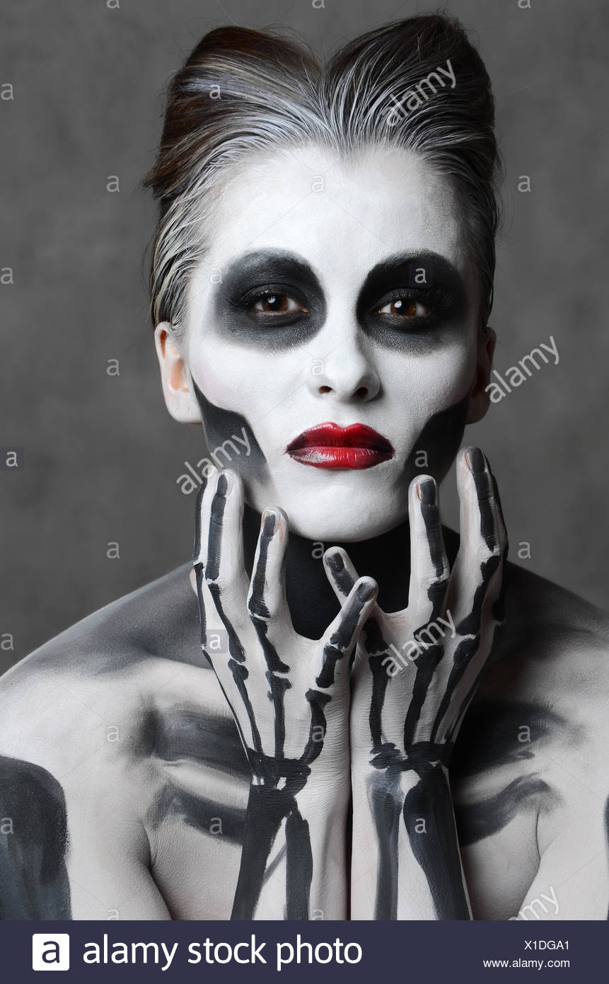 young woman with dead mask skull face art halloween face stock image