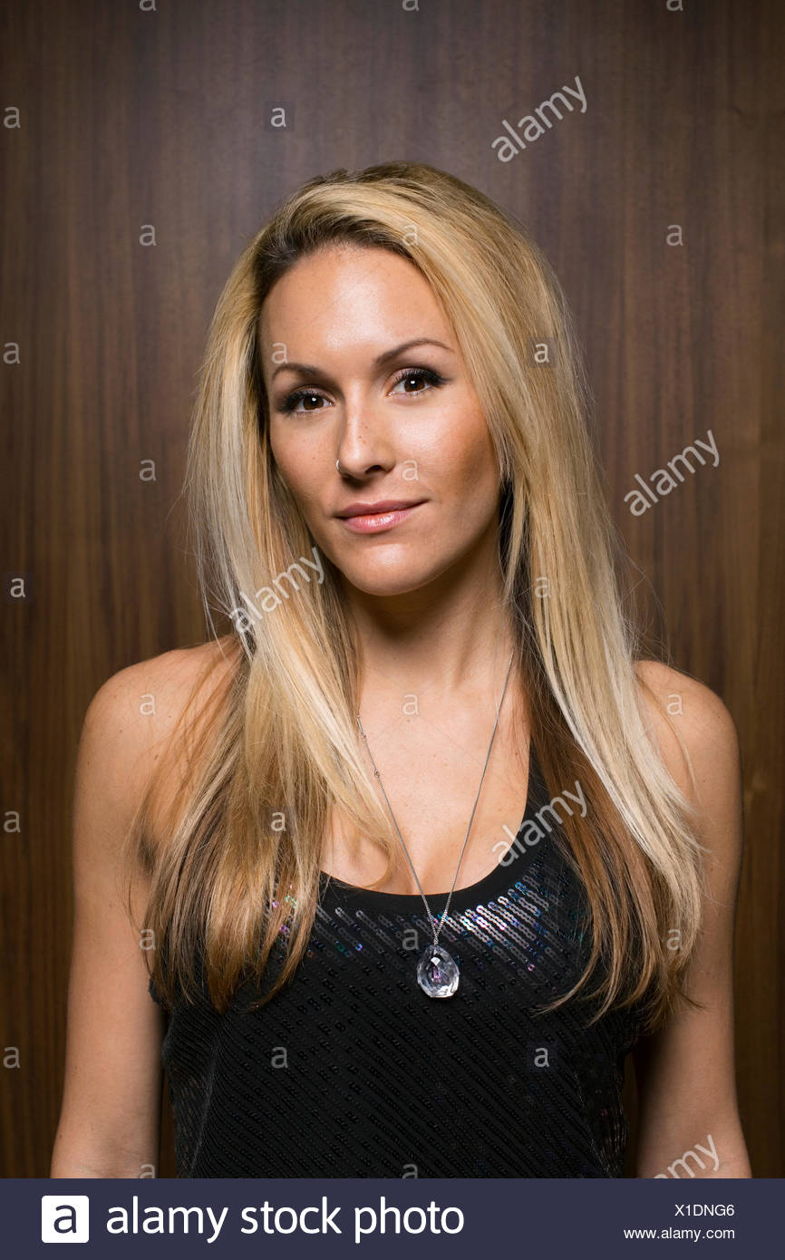 Portrait of blonde woman wearing sleeveless top - Stock Image
