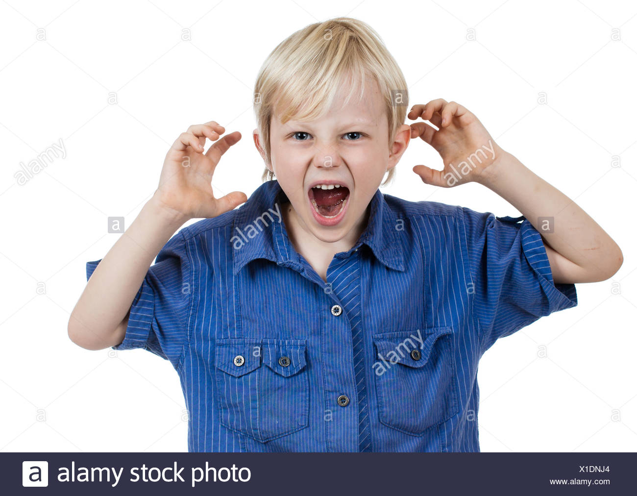 Angry frustrated young boy - Stock Image
