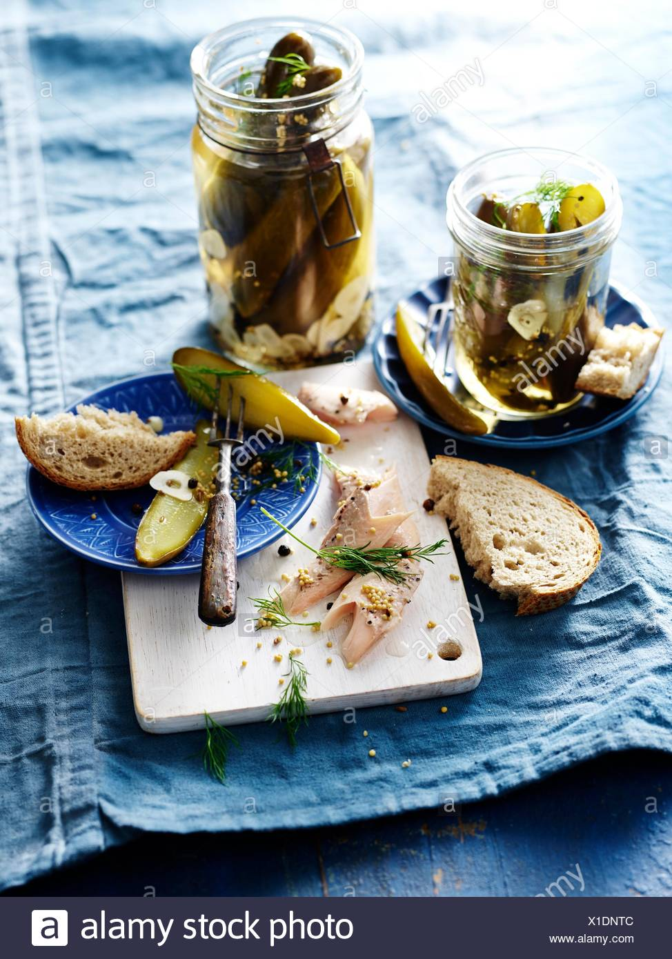 Dill Pickles with bread, close-up - Stock Image