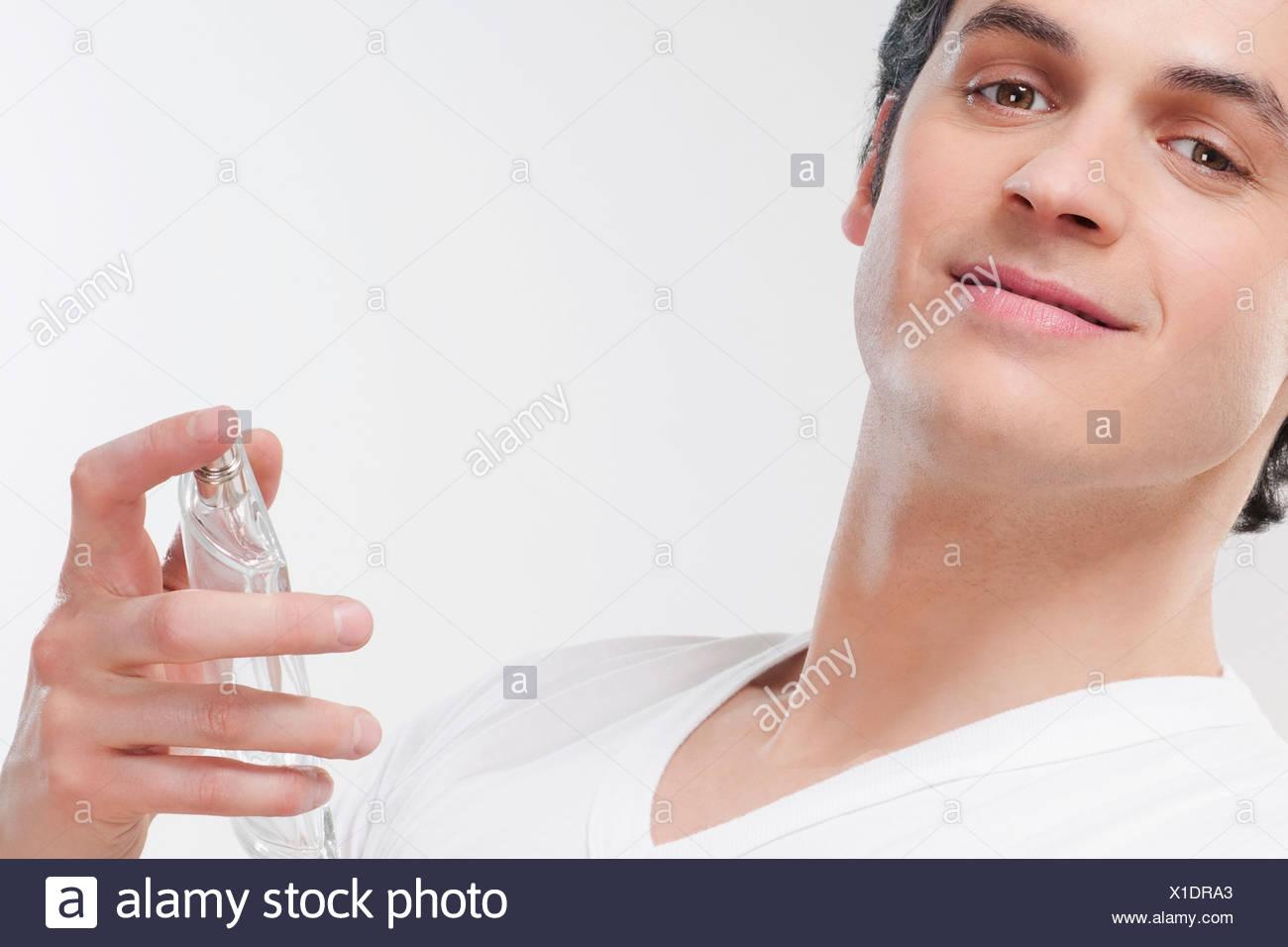 Man holding a perfume bottle - Stock Image