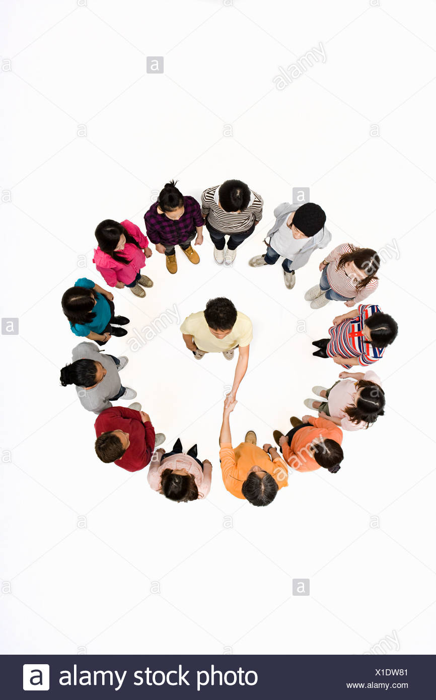 Person in circle shaking hands - Stock Image