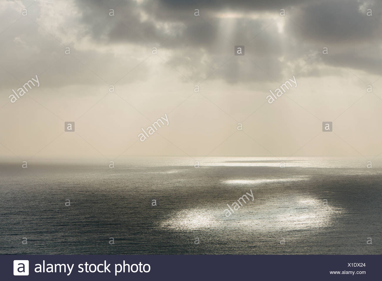 Shafts of sunlight shining through cloud and a view over  Pacific Ocean at Manzanita Oregon. - Stock Image