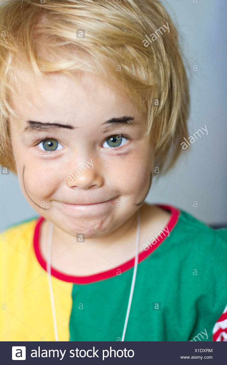 Portrait of girl with painted face, smiling, close up - Stock Image