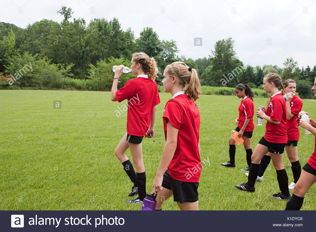 Girl soccer players on field - Stock Image
