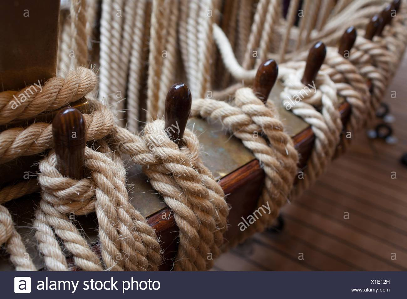 Hemp ropes tied to wooden beams, part of the rigging system
