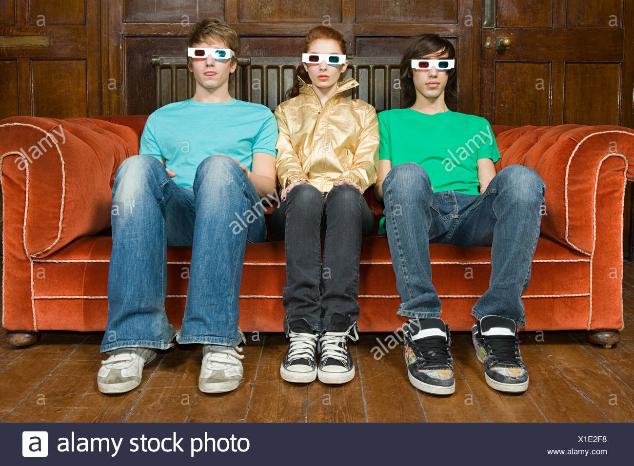 Three teenagers wearing 3d glasses - Stock Image