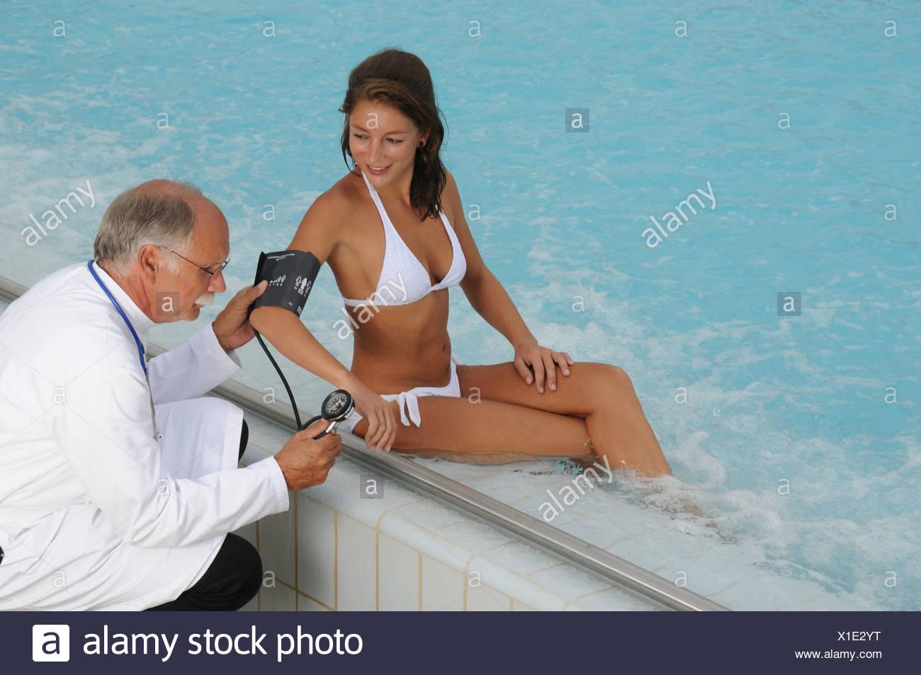Wellness, bath, doctor, treatment, processing, health, Beauty farm, investigation, woman, swimming-pool, pool, blood pressure - Stock Image