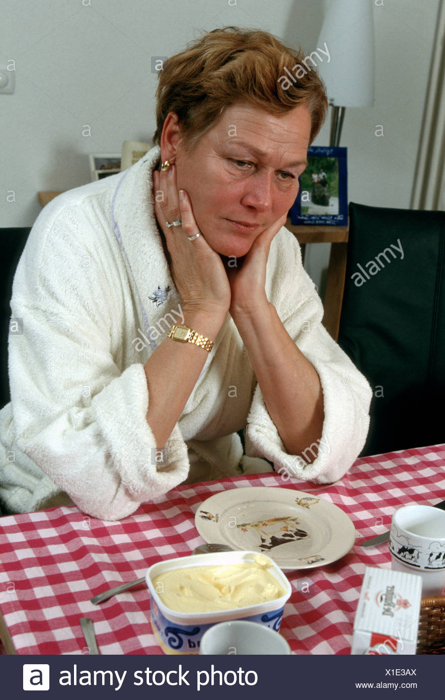 Depressed woman or mature woman alone sadness - Stock Image