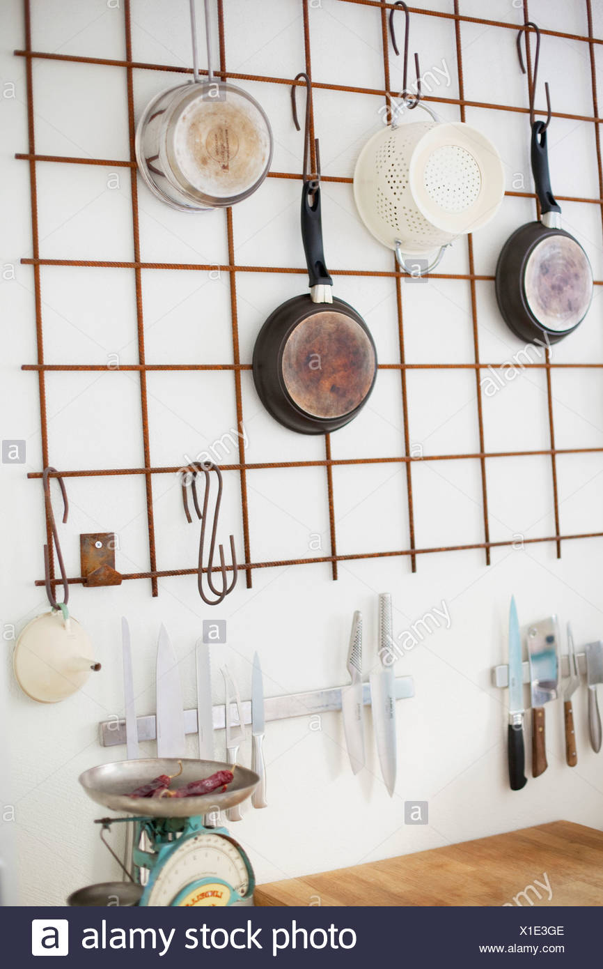 Kitchenware on wall - Stock Image