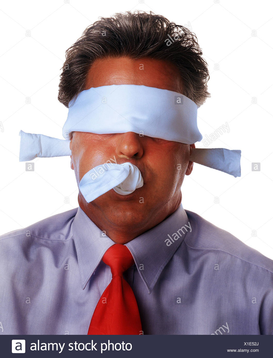 Businessman, toggle, blindfold, 'nothing say', hear 'nothing', 'nothing see to speak', portrait, Men, man, cloth, node, criminal activity, hostage, dumbfounded, quiet, silence, hide, trapped, eyes, online, earplug, studio, cut out - Stock Image