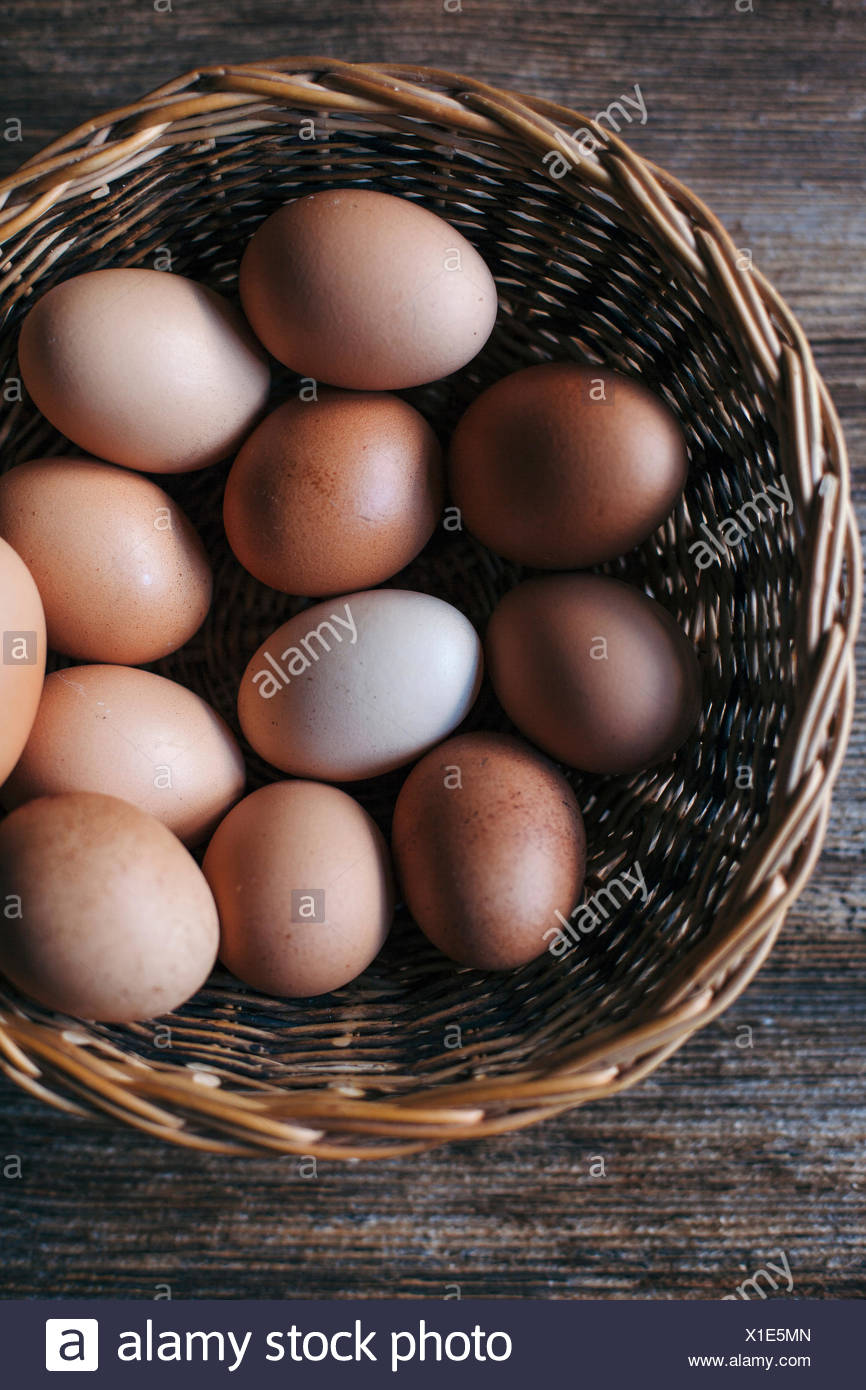 Organic eggs in a basket Stock Photo