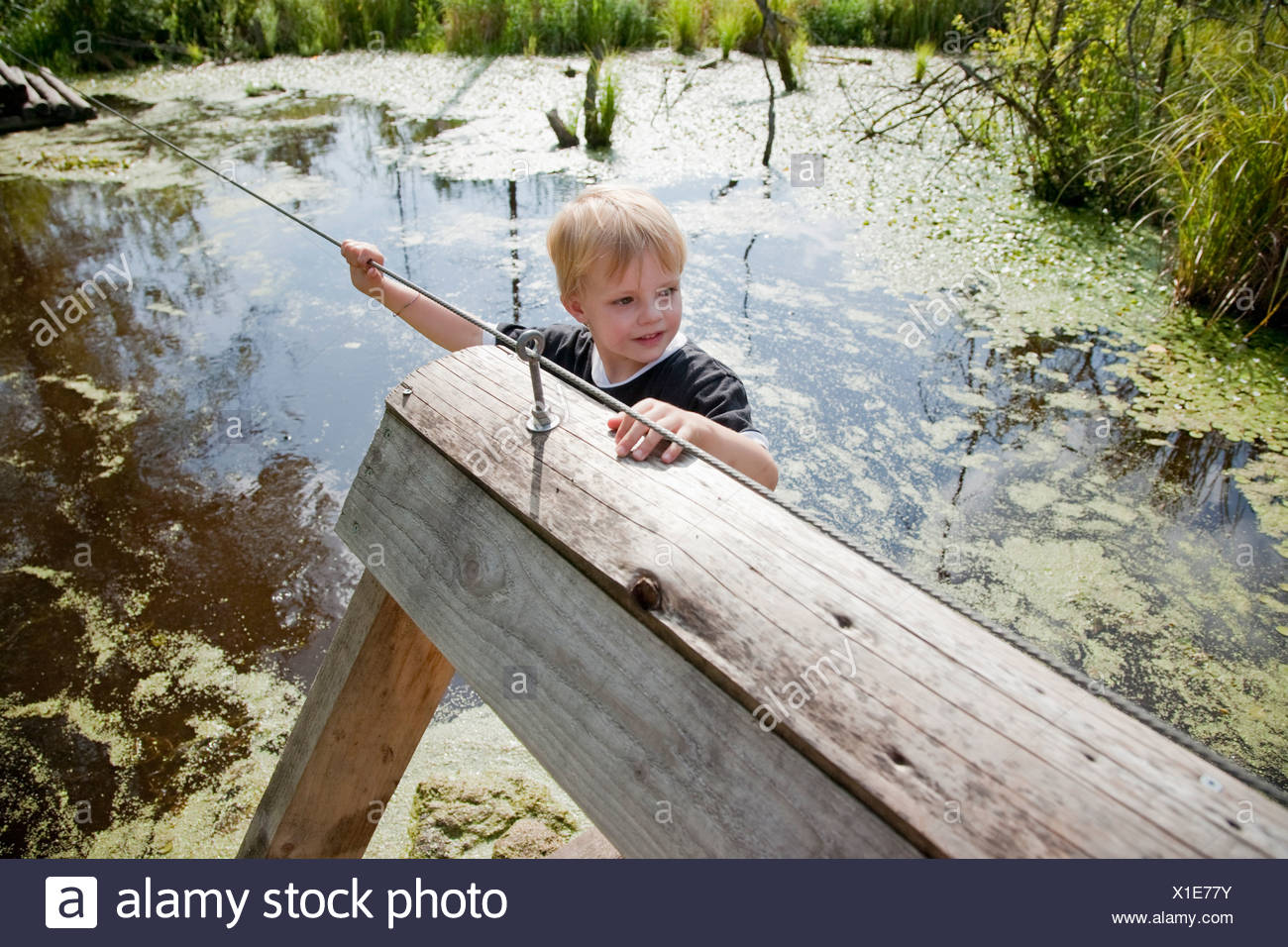 Boy on a float - Stock Image