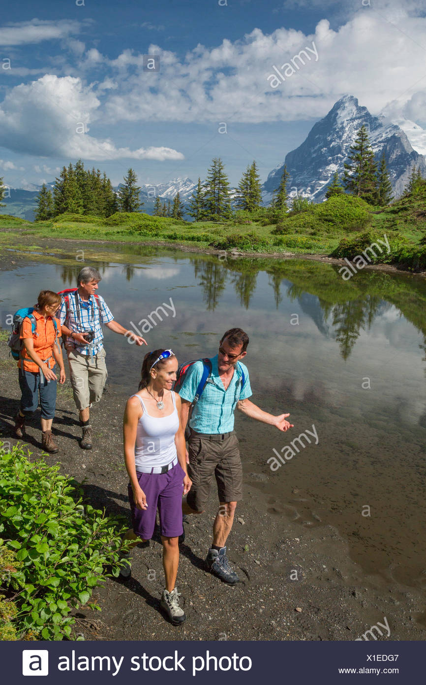 Hiker in mountain lake on Grosse Scheidegg, - Stock Image