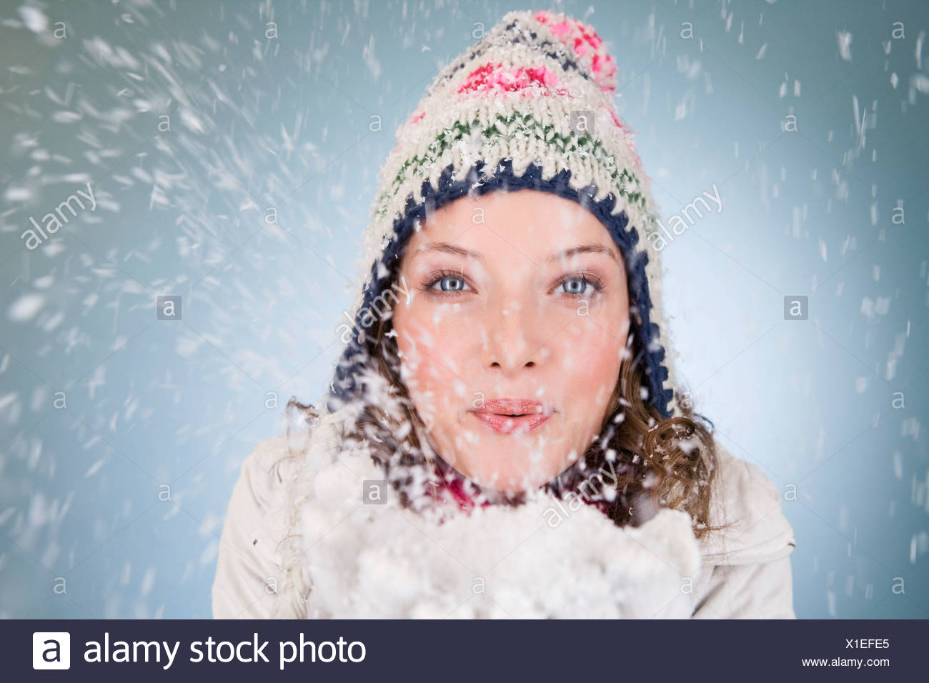 2489df36d15b3 Young Woman Blowing Snow Stock Photos   Young Woman Blowing Snow ...