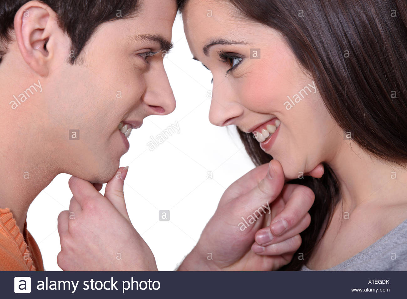 Young couple gazing lovingly into each other's eyes - Stock Image
