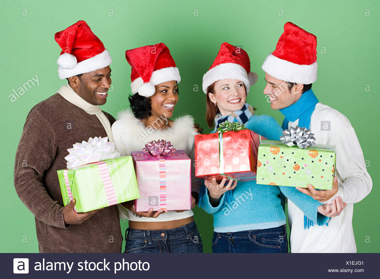 Group of friends with presents - Stock Image