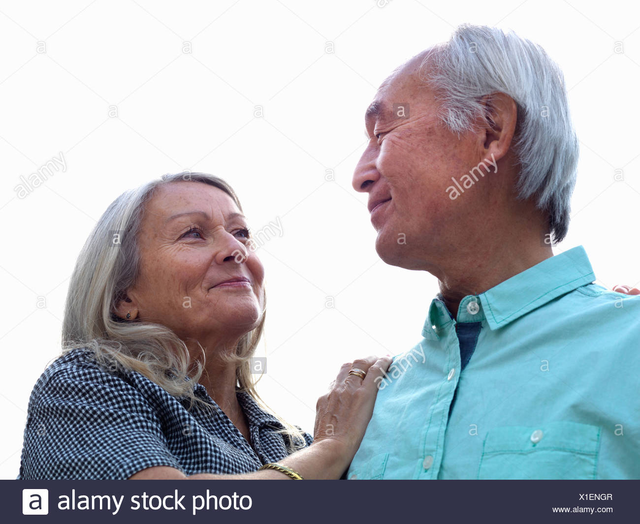 Older couple smiling together - Stock Image