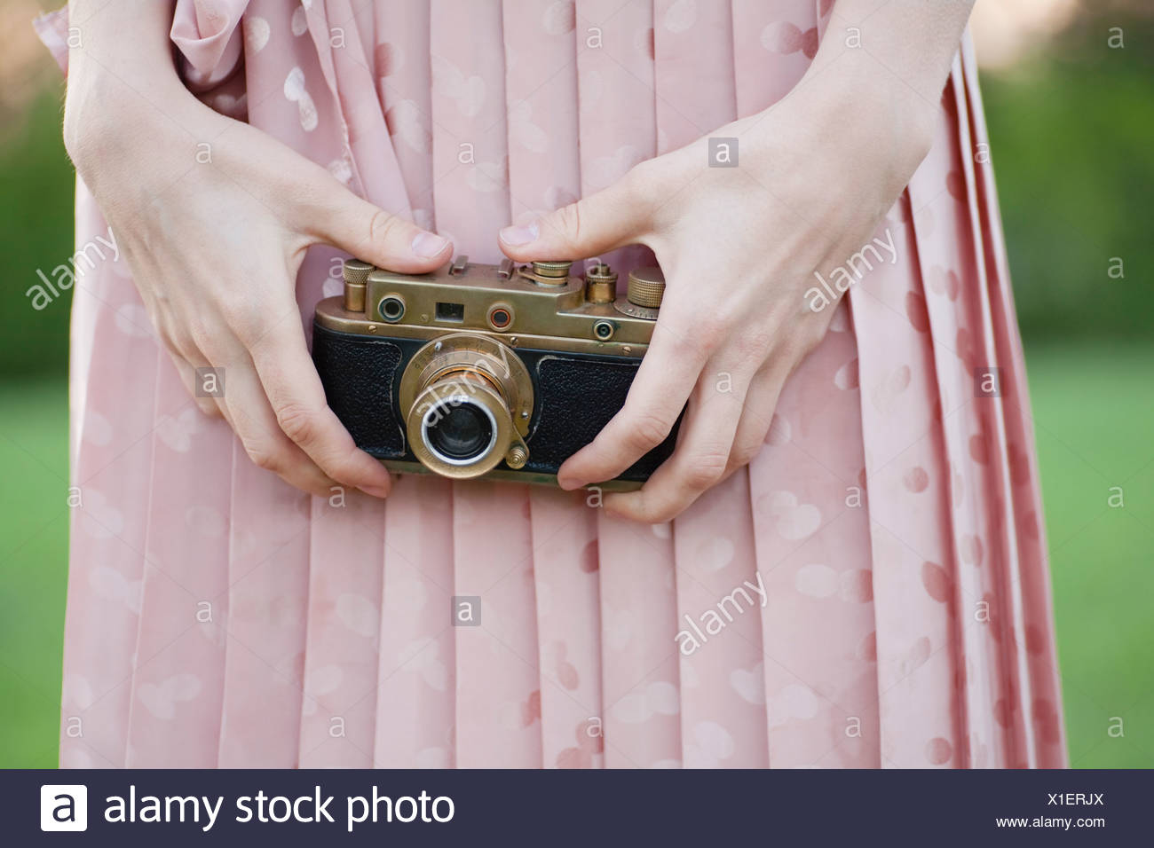 Russia, Voronezh, midsection of woman holding old camera Stock Photo