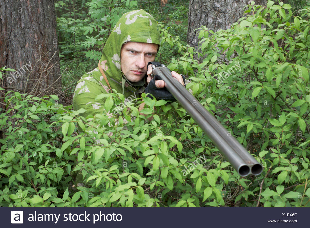 Angry hunter with an old gun - Stock Image