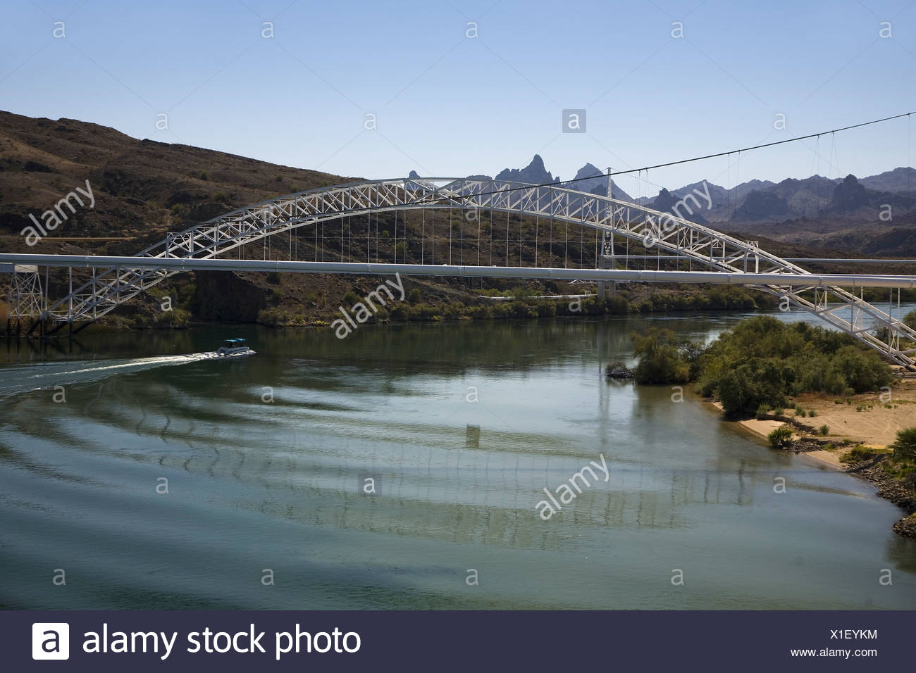 Bridge crossing Colorado River with turquoise color water from