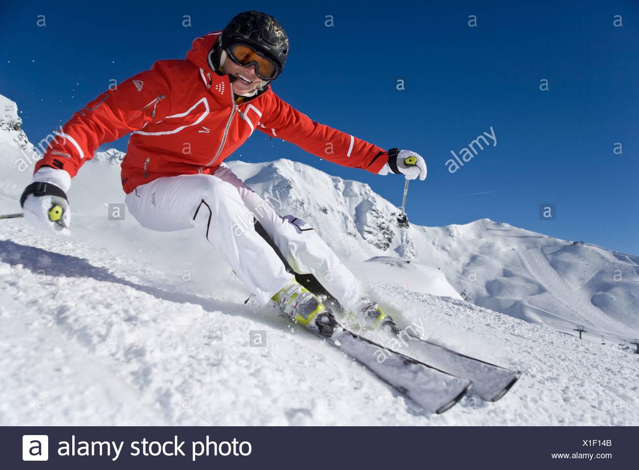 Woman ski carving skiing winter sports