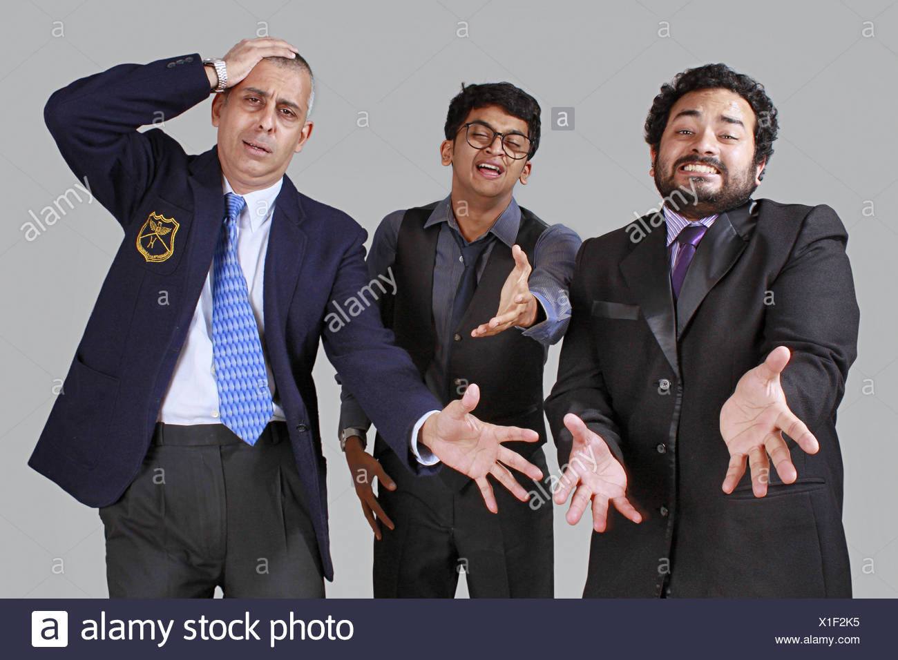 Three business men expressing sorrow over a disaster - Stock Image