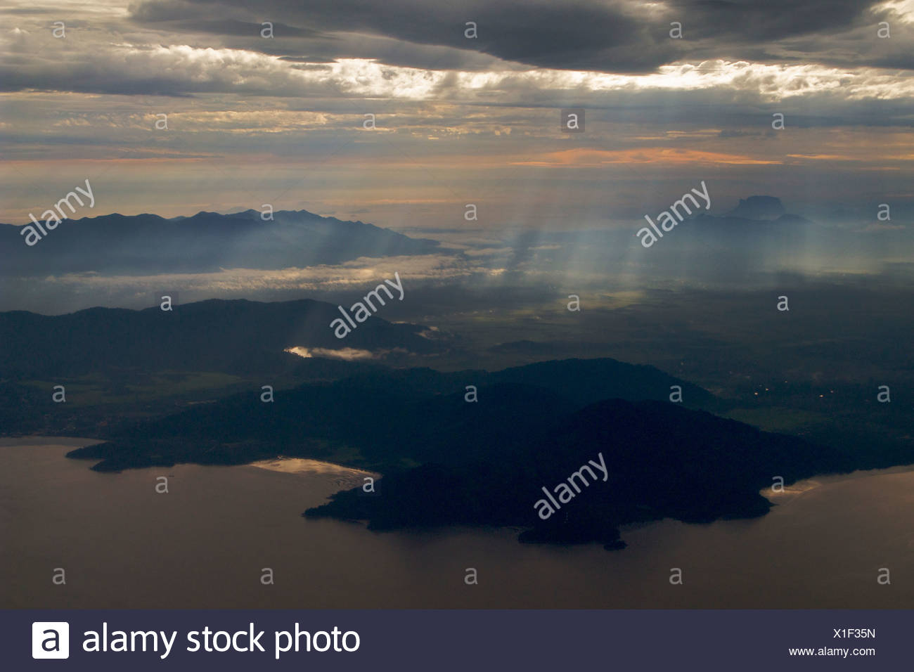 Sukadana and Gunung Palung from the air just off the coast. - Stock Image