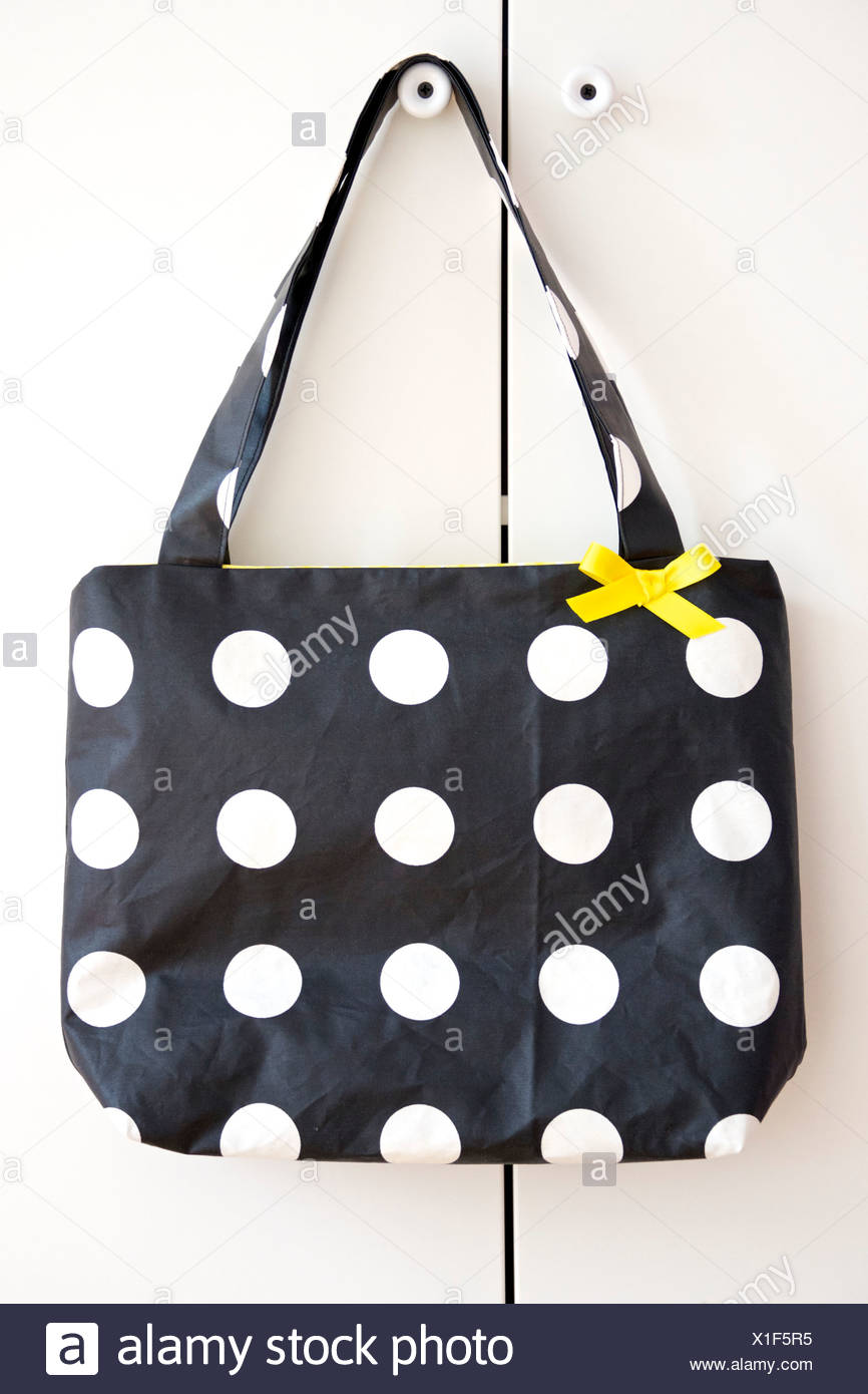 Black Handbag With White Dots, Munich, Bavaria, Germany - Stock Image