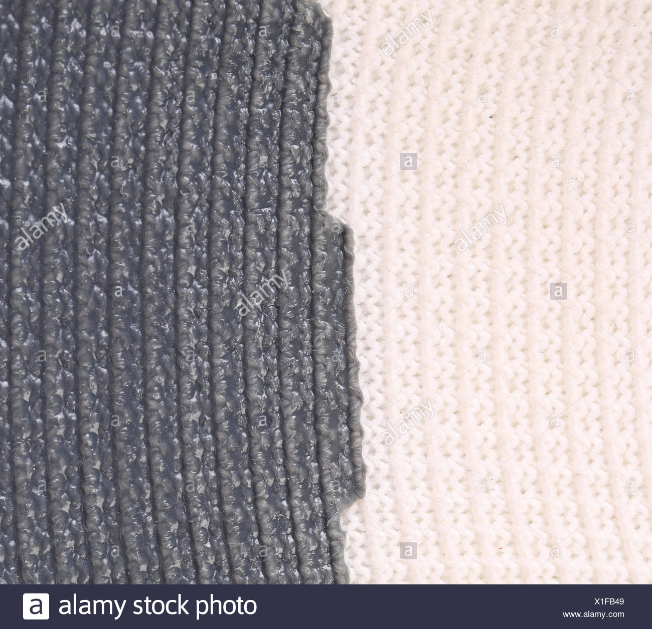 Close up of vertical knitted fabric texture. - Stock Image