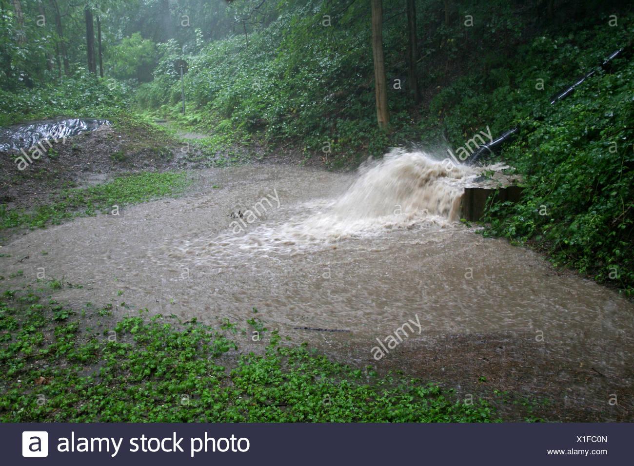 mass of water flooding a rainwater retention basin, Germany, North Rhine-Westphalia - Stock Image