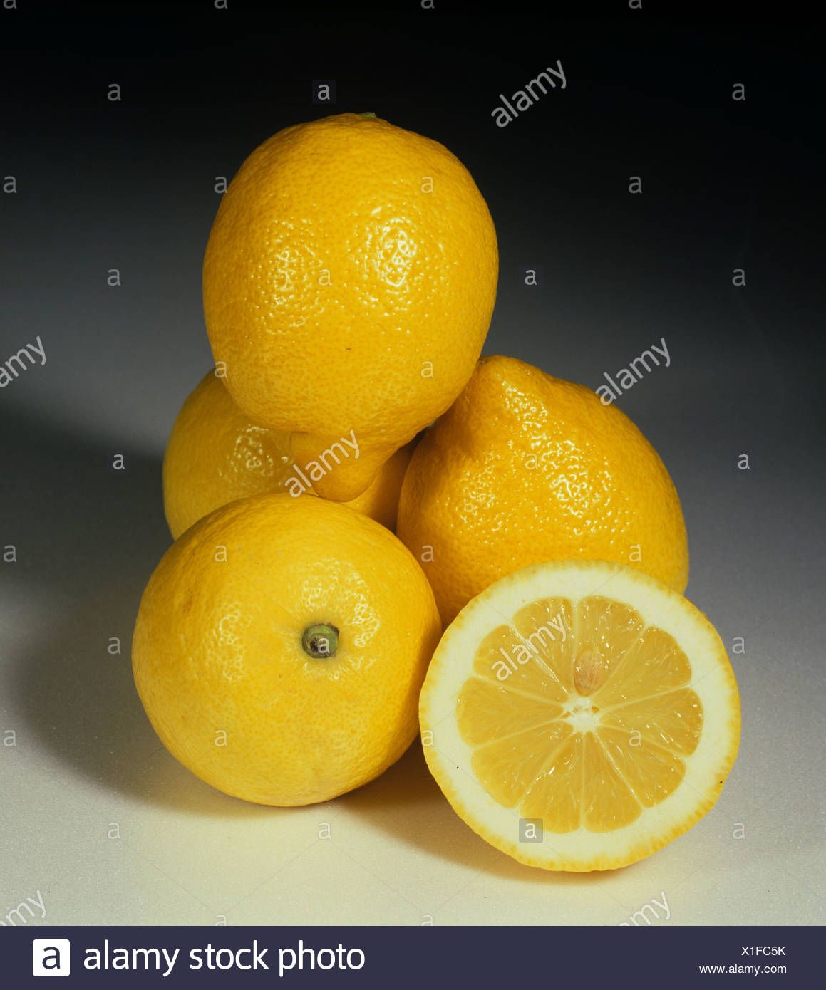 Whole and section group of citrus fruit lemon variety Fino - Stock Image