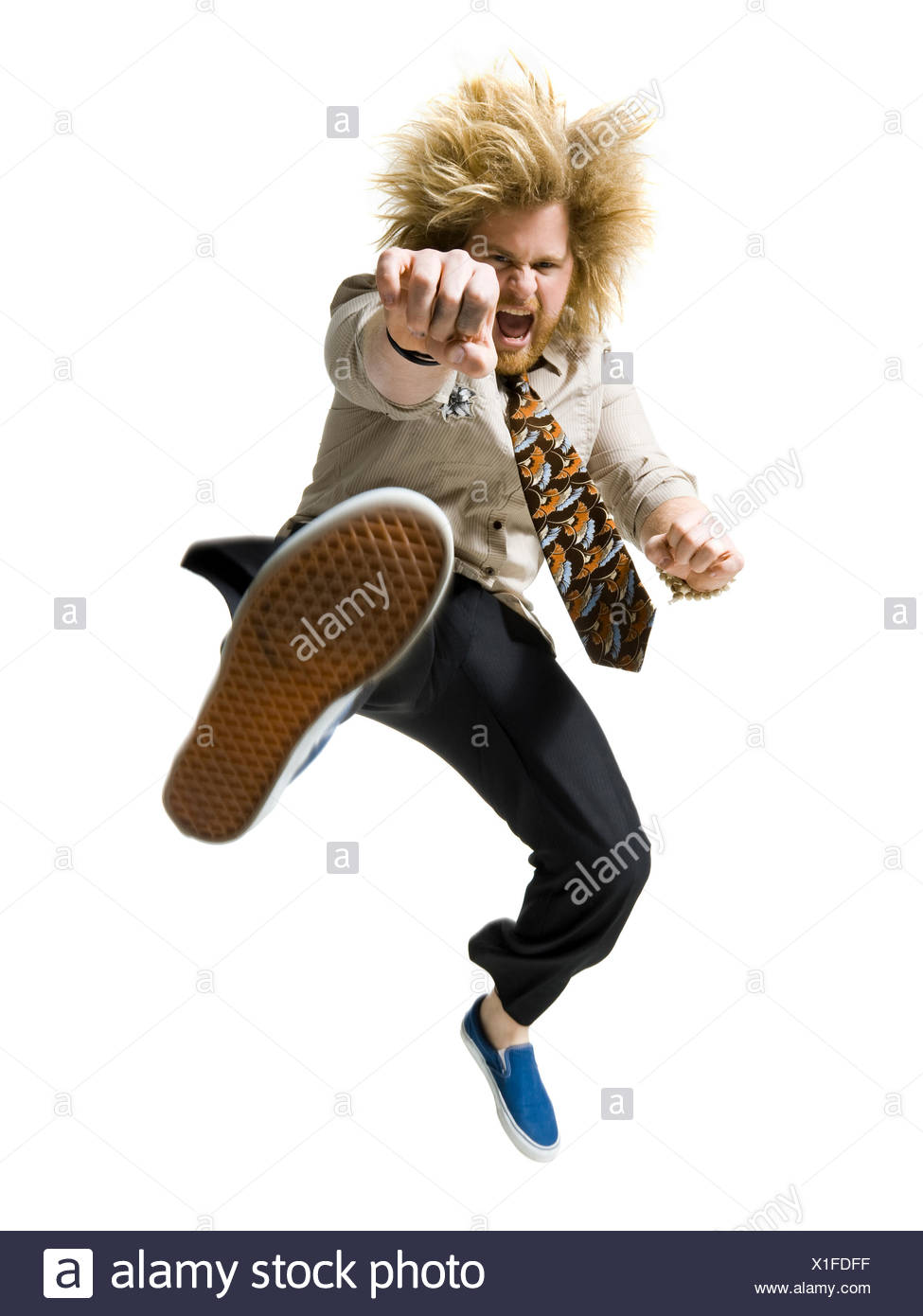 man kicking the air - Stock Image