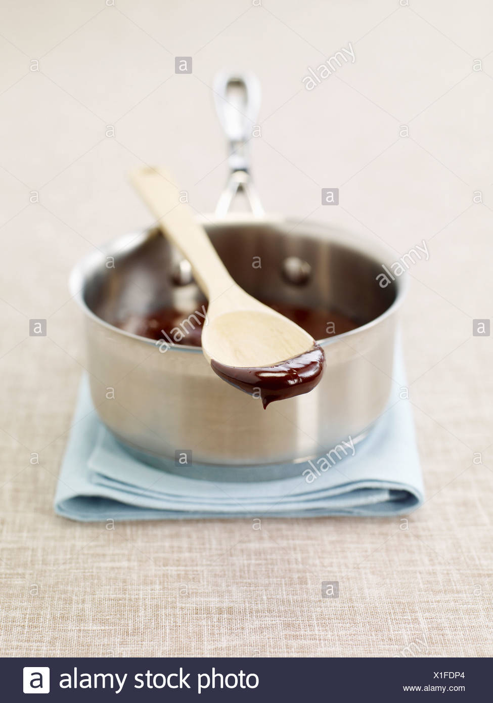 Melted chocolate in a saucepan - Stock Image
