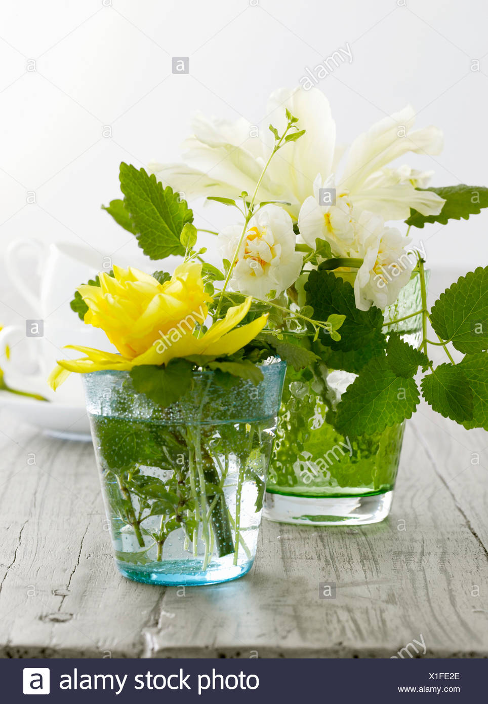 Table Decoration Of Spring Flowers In Glasses Stock Photo 276320870