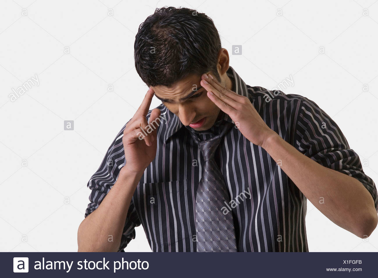 Man getting a headache - Stock Image