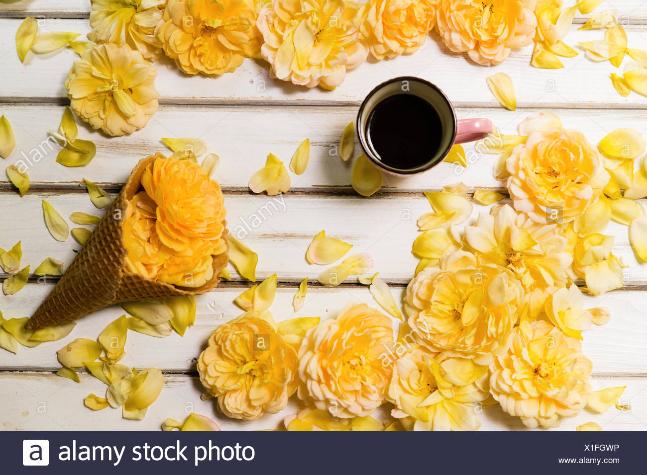 Yellow roses, Conceptual  ice-cream cone and cup of coffee Stock Photo