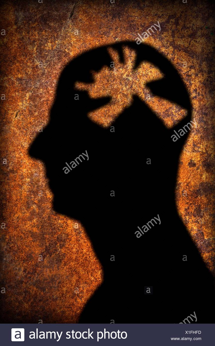 Silhouette of person's head with mental health issues, computer artwork. - Stock Image