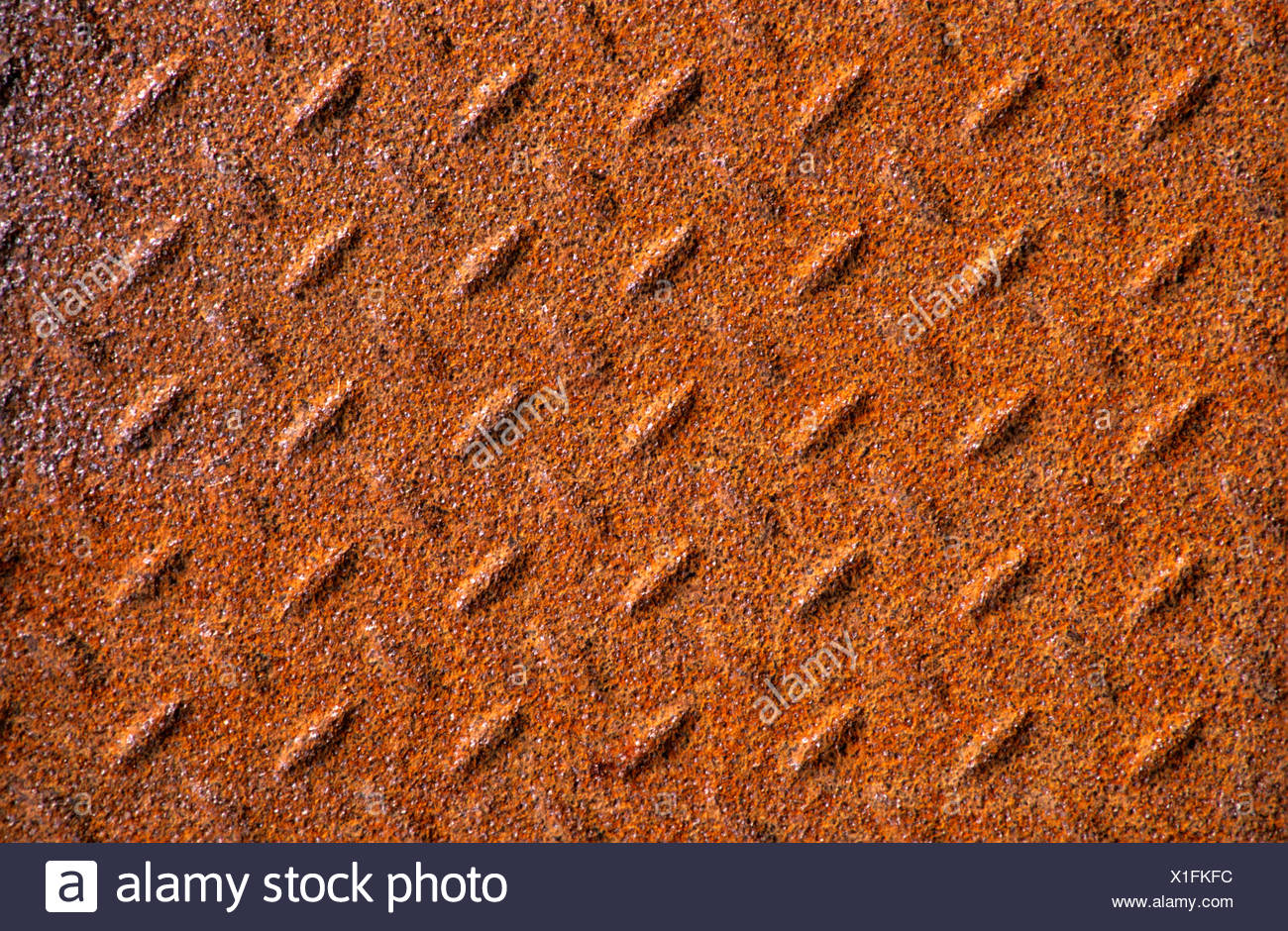 Rust-coloured metal surface - Stock Image