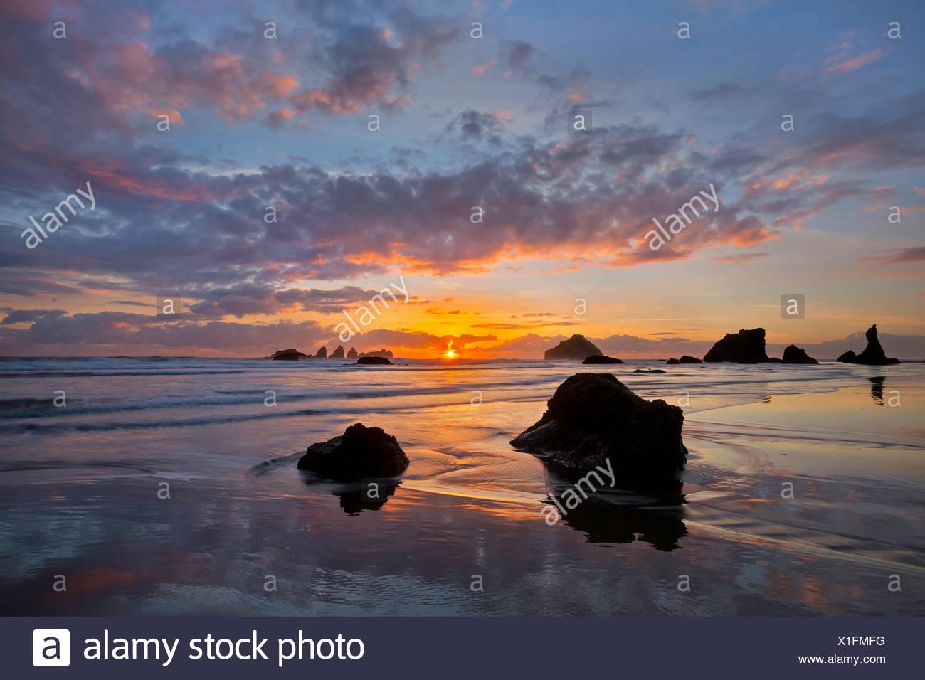 Tidepools and sea stacks, rocks, at sunset along Bandon Beach, Oregon. Winter. USA - Stock Image
