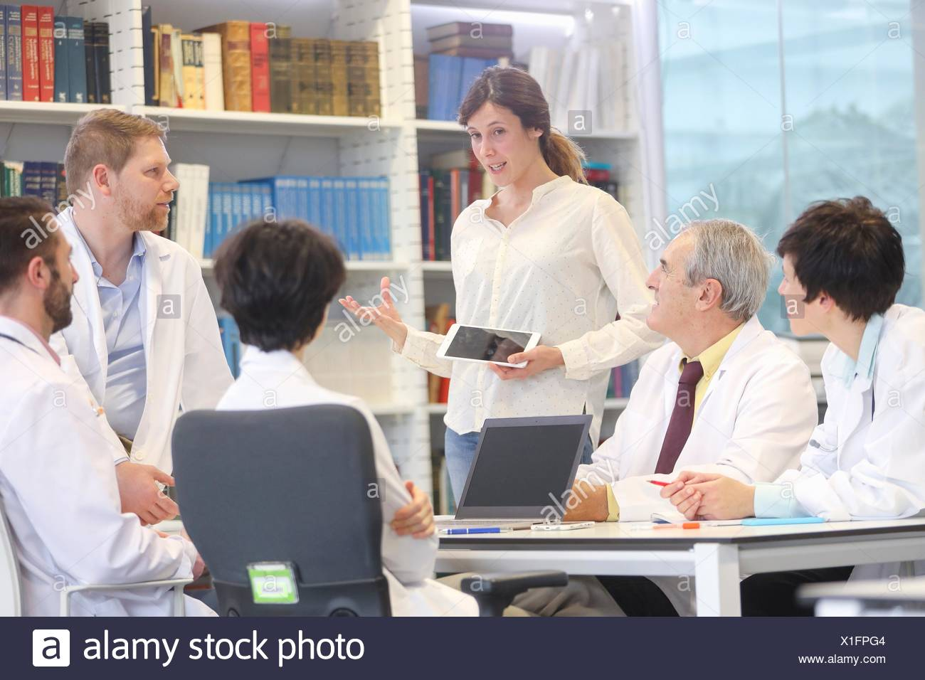 Saleswoman at doctors´ meeting, clinical session, Hospital, Donostia, San Sebastian, Gipuzkoa, Basque Country, Spain - Stock Image