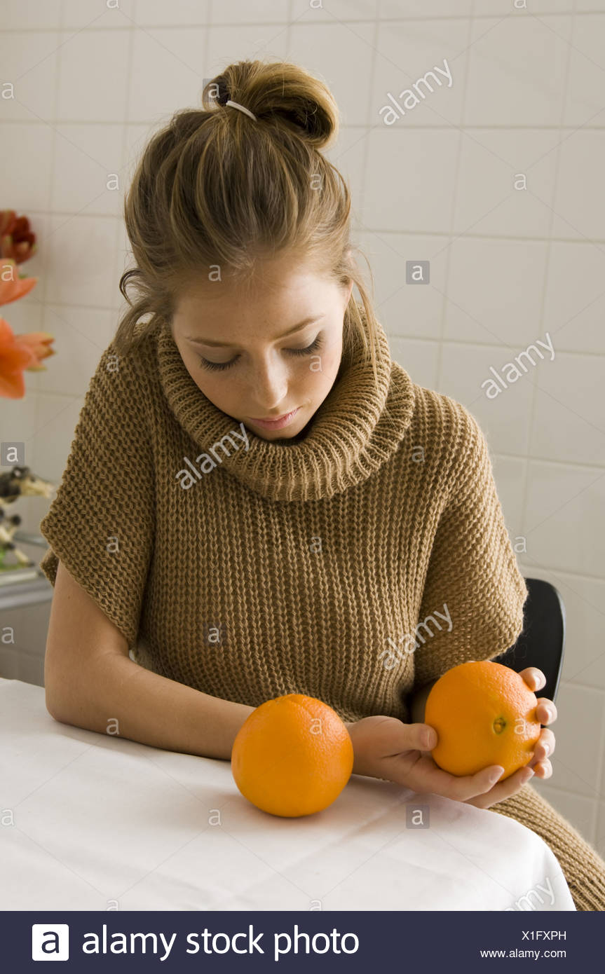 woman with oranges - Stock Image