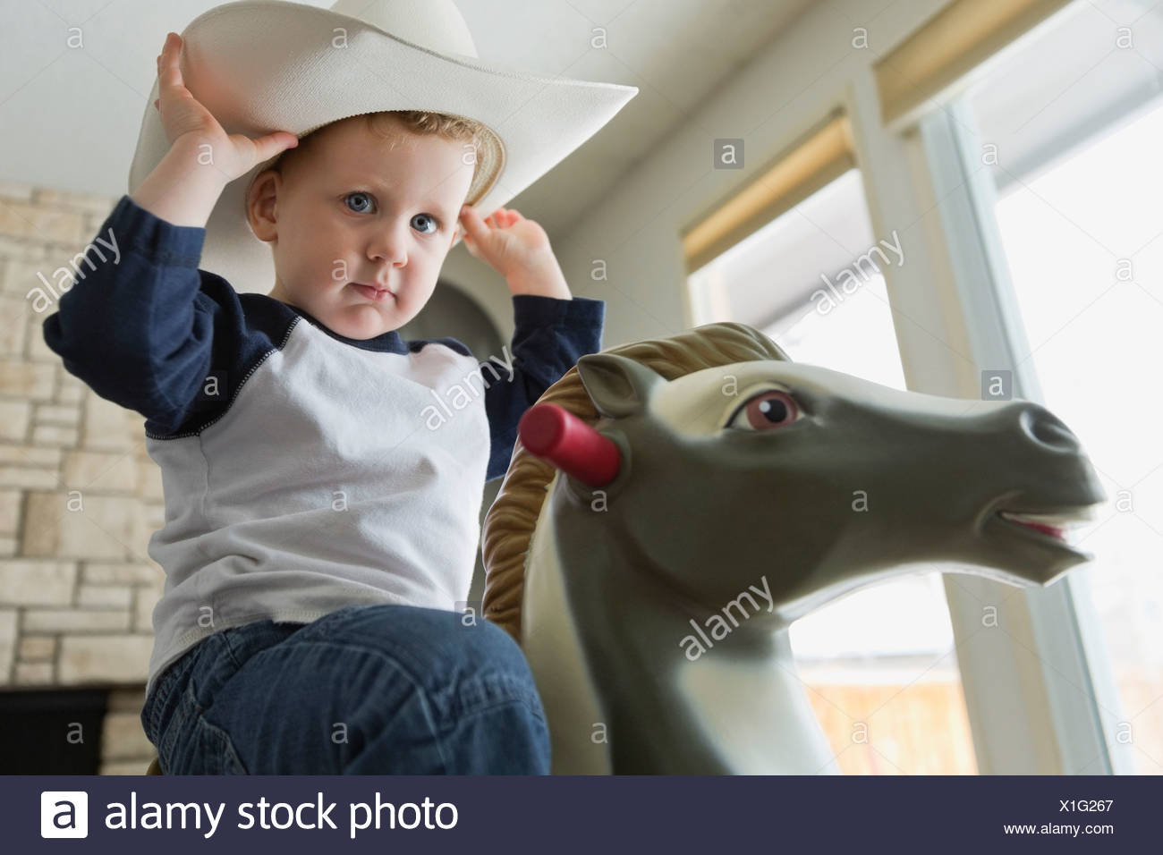 Portrait of little boy dressed as cowboy - Stock Image