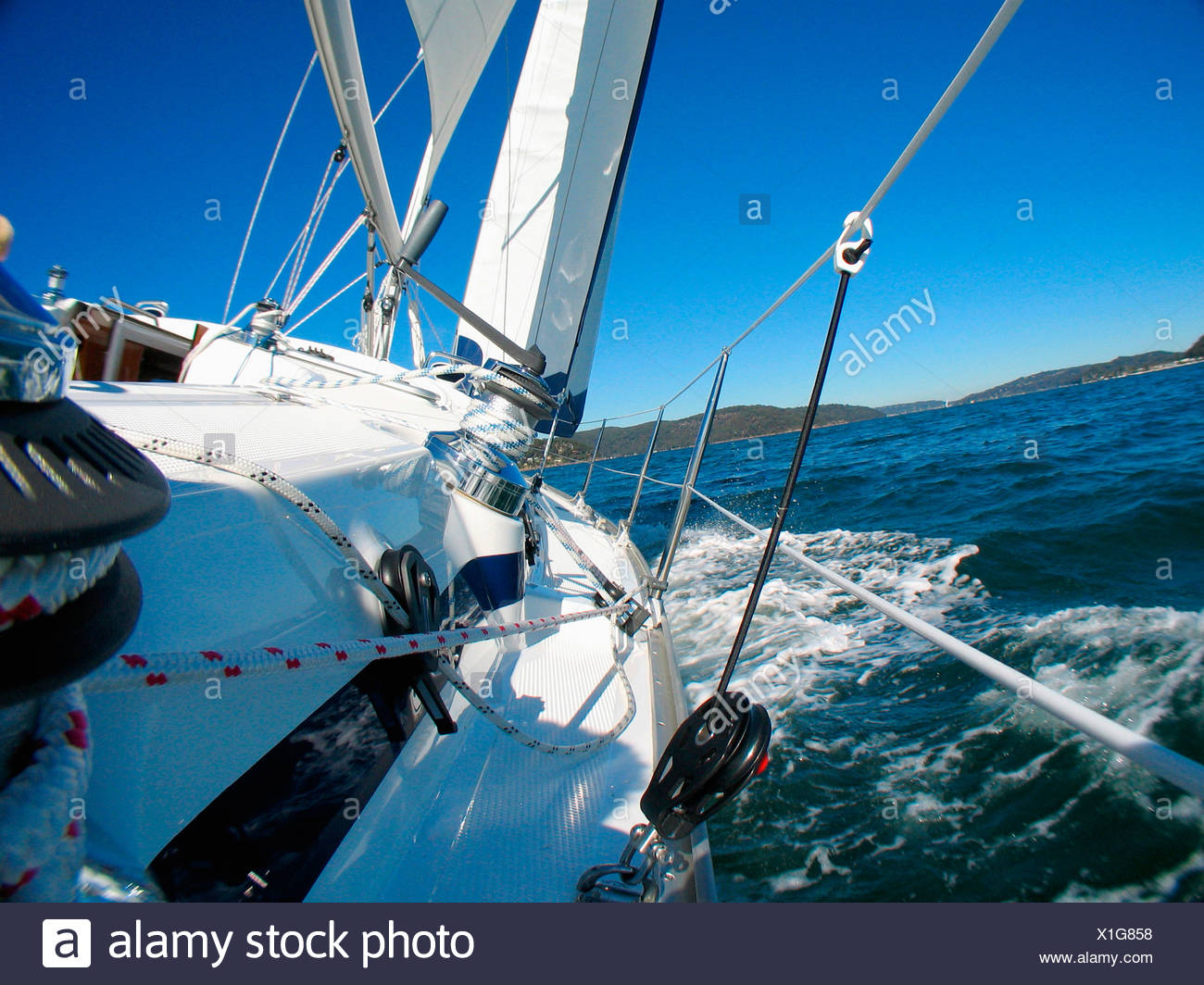 View from a deck on board a yacht cruising in Pittwater on the North Shore from Sydney, Australia. - Stock Image
