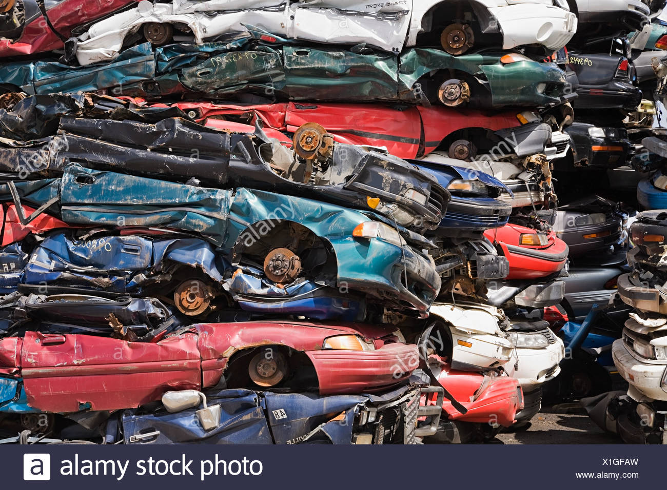 Stacks of crushed cars - Stock Image
