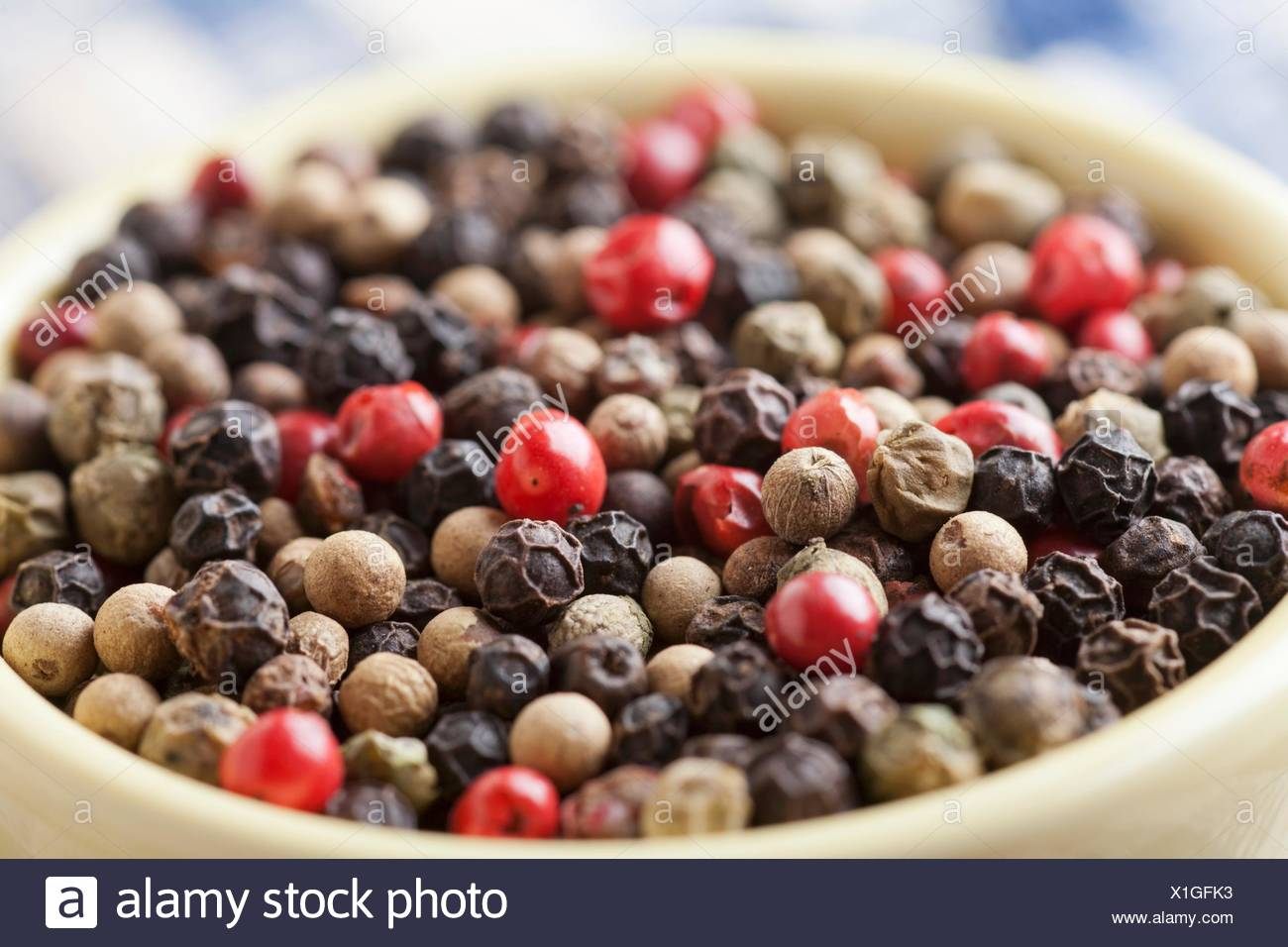 Bowl of Multi-Colored Peppercorns; Close Up - Stock Image