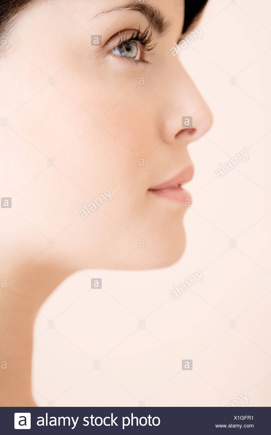 Profile of young woman's face - Stock Image