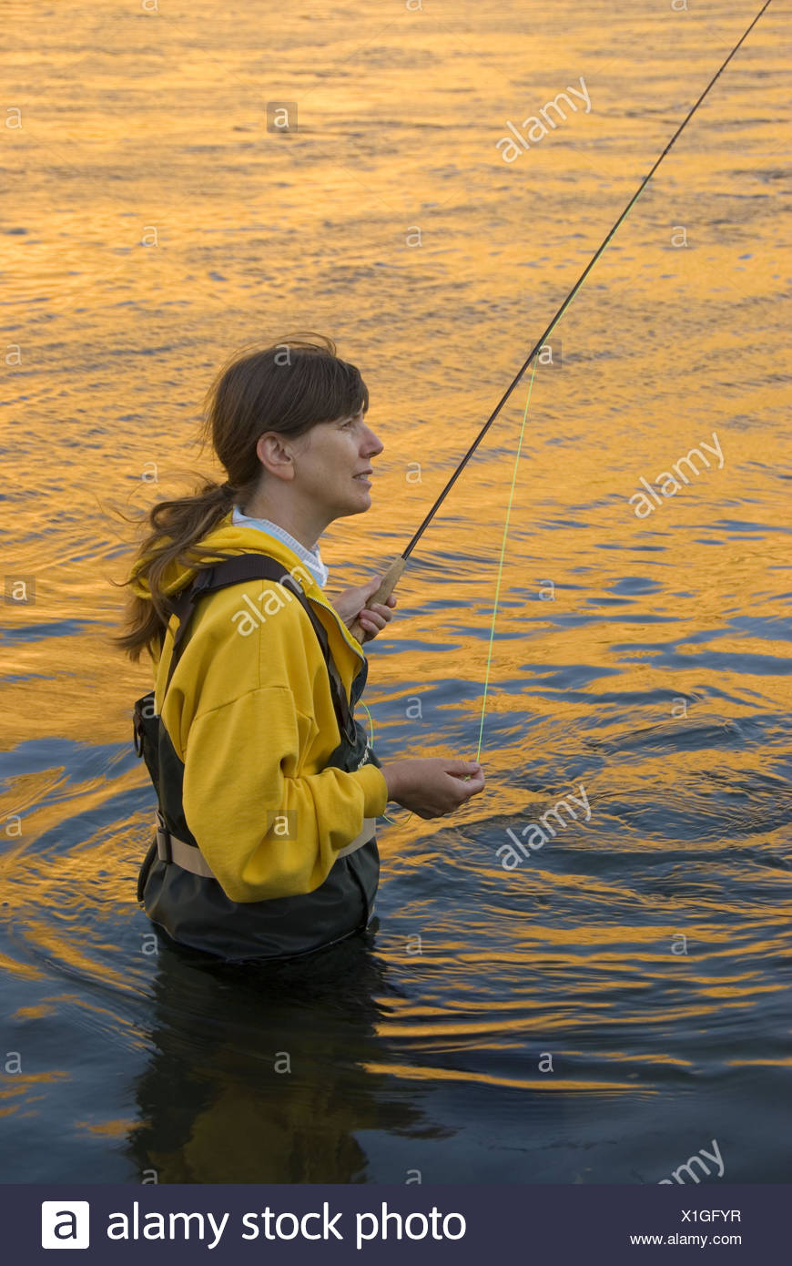 Flyfishing with river glow, Deschutes River State Park, Deschutes Wild and Scenic River, Columbia River Gorge National Scenic - Stock Image