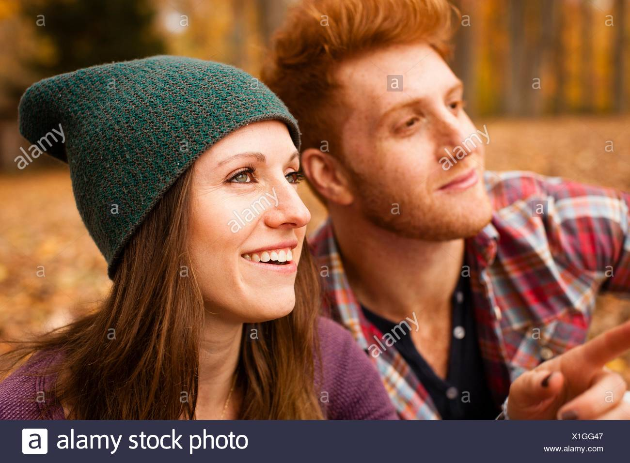 Happy young couple in autumn forest Stock Photo