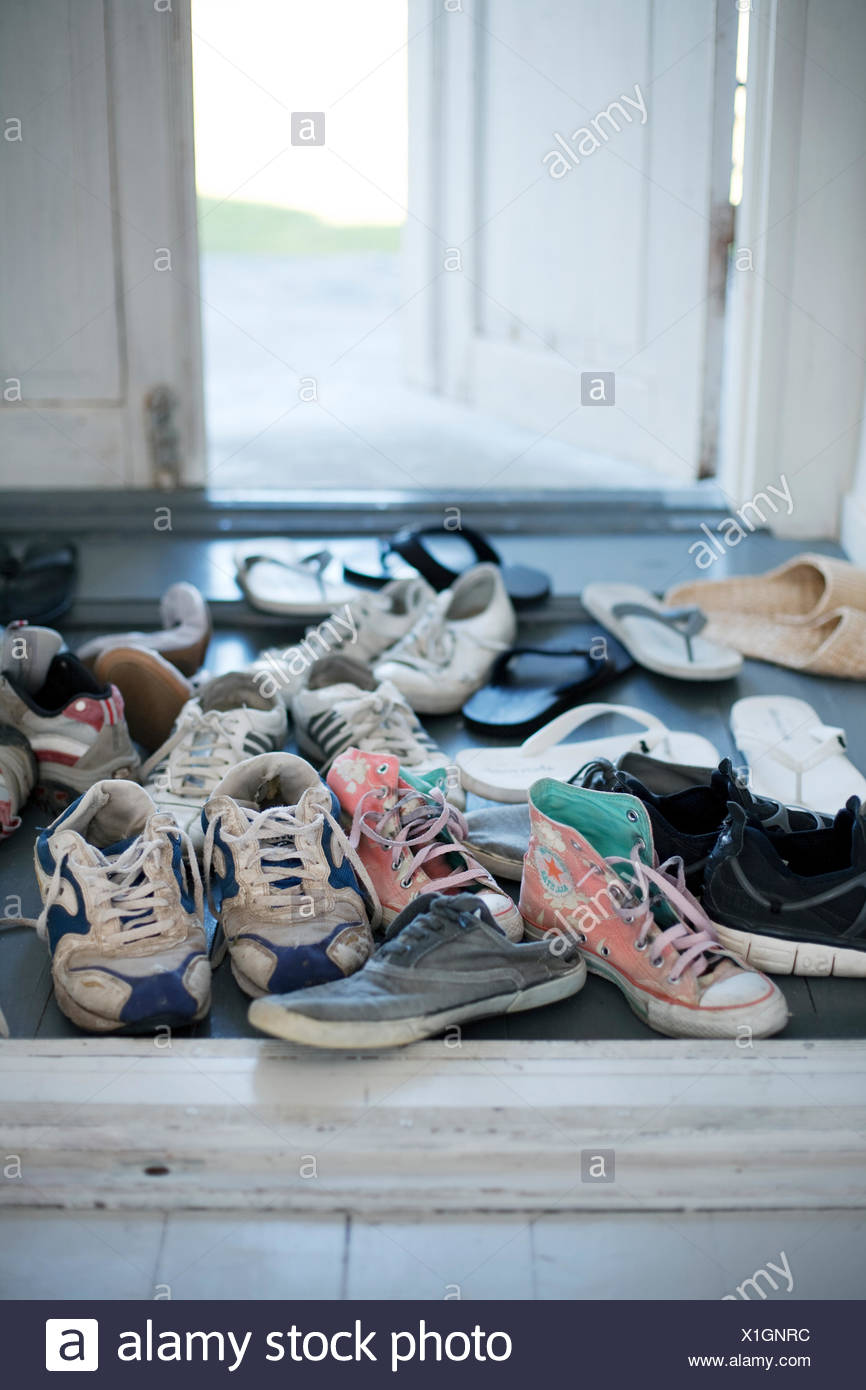 Sweden, Gotland, Shoes in hallway Stock Photo